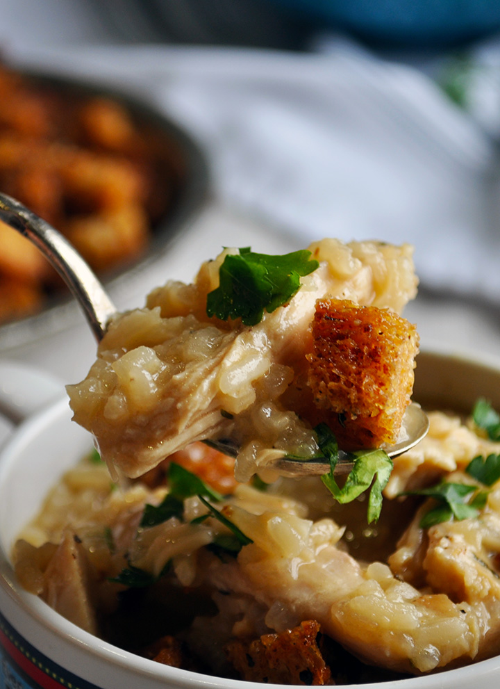 A spoonful of creamy chicken and rice soup