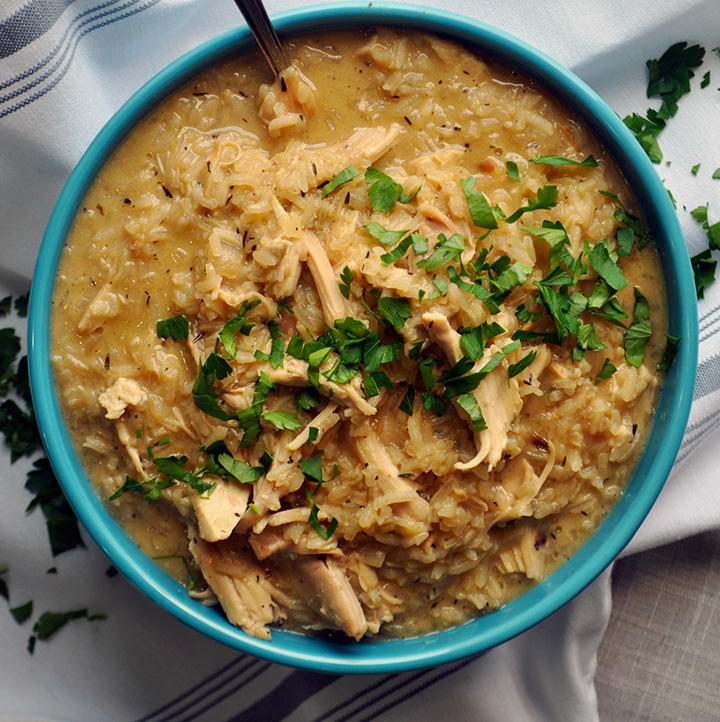 A bowl of creamy chicken and rice soup