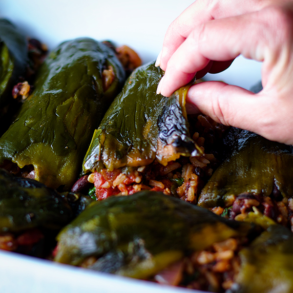 Making stuffed poblano peppers with rice, beans and enchilada sauce.