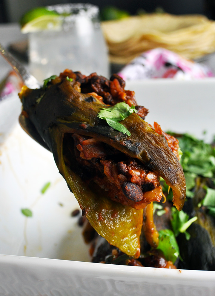 Stuffed poblano peppers with rice, black beans, chilis, and tomatoes