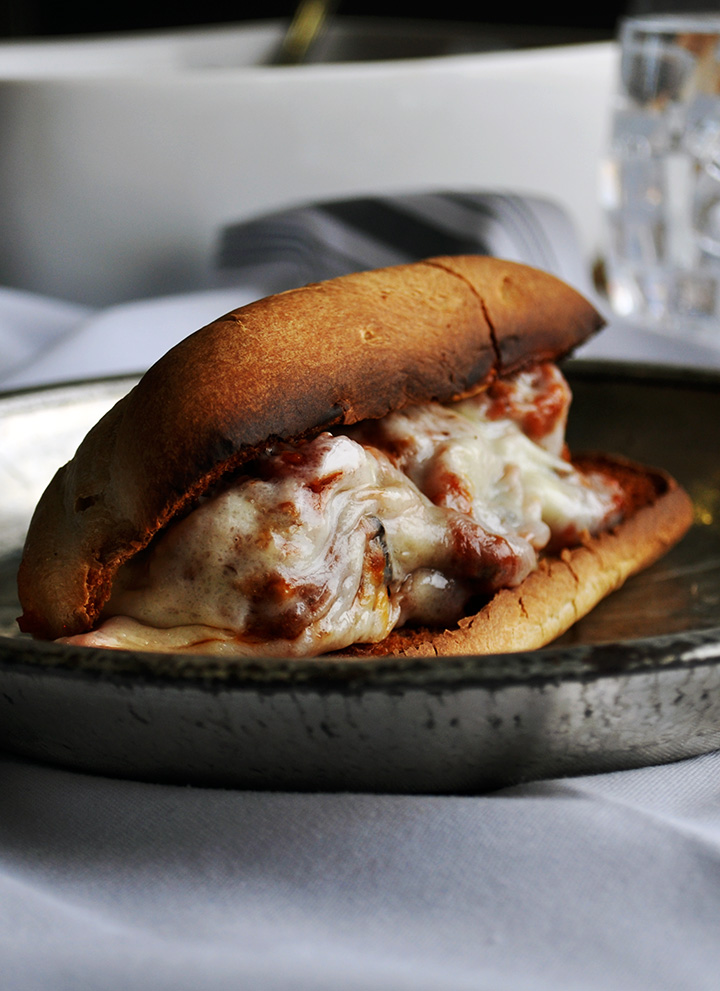 Meatball sandwich with marinara and provolone.
