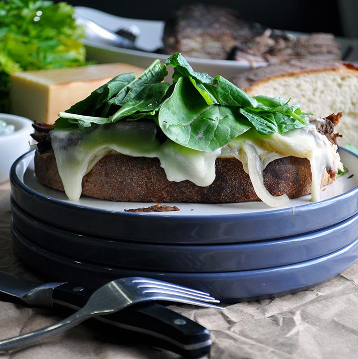 An open face Pot roast sandwich on a plate