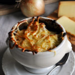 A bowl of crock pot French onion soup.