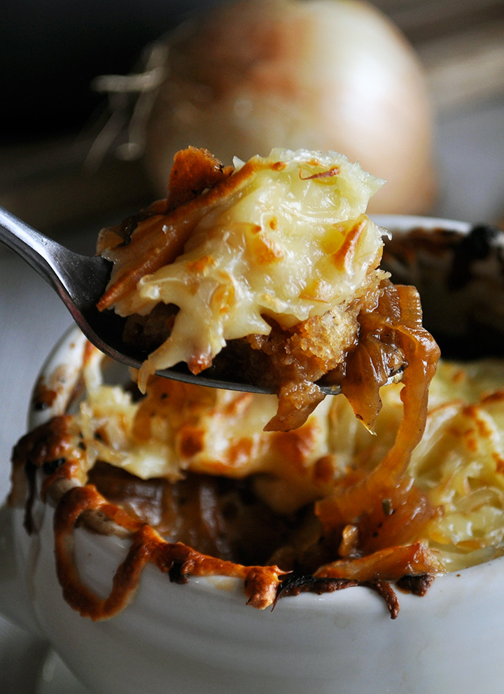 A spoonful of crock pot French onion soup.