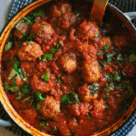 Homemade meatballs in marinara sauce.