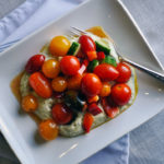 Tomato cucumber salad over basil whipped ricotta.