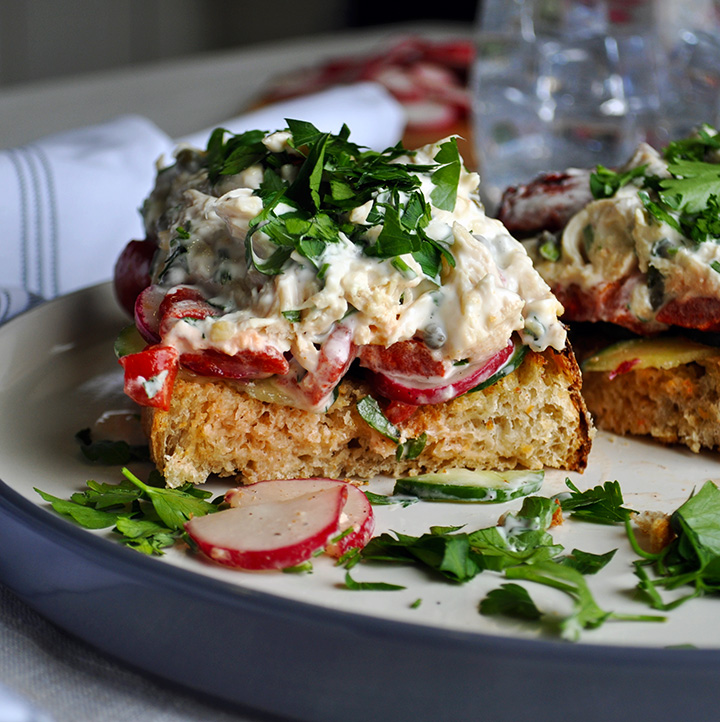 Open face Chicken salad sandwiches with tarragon, capers, roasted red peppers, radishes, and cucumbers.