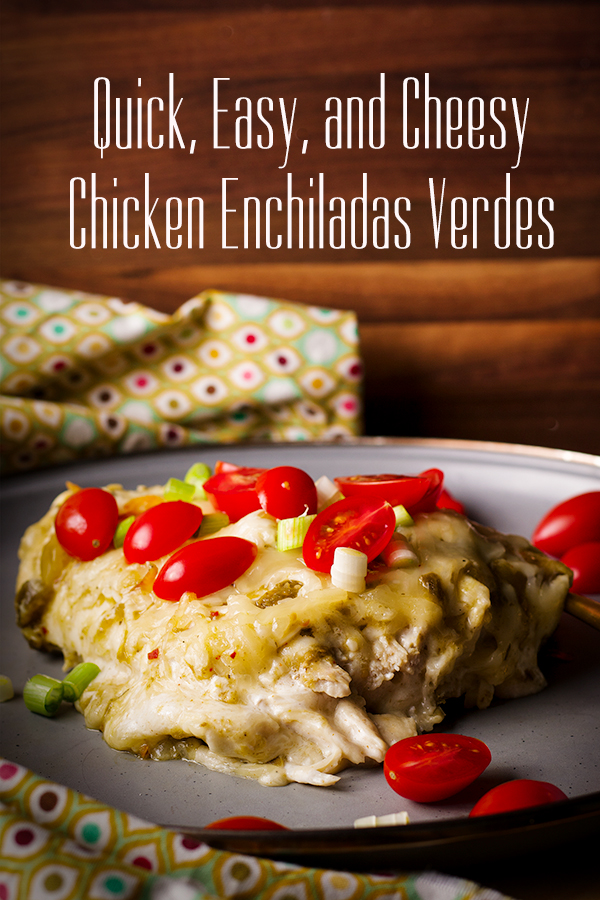 A plate of Chicken Enchiladas Verdes topped with fresh tomatoes and green onions.