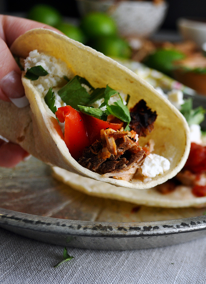 A carnitas taco made with slow cooker carnitas.