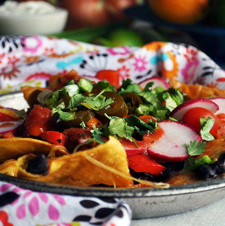 A plate of veggie black bean nachos.