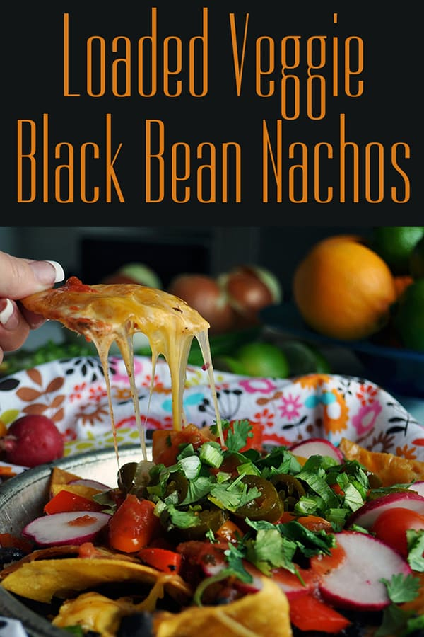 Taking a bite of veggie black bean nachos.