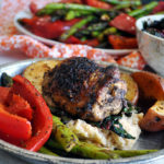 Sheet Pan Cajun Chicken and Vegetables over Cheesy Grits.