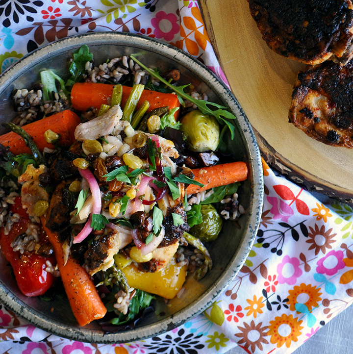 A plate of chili glazed chicken salad with roasted vegetables and agrodolce