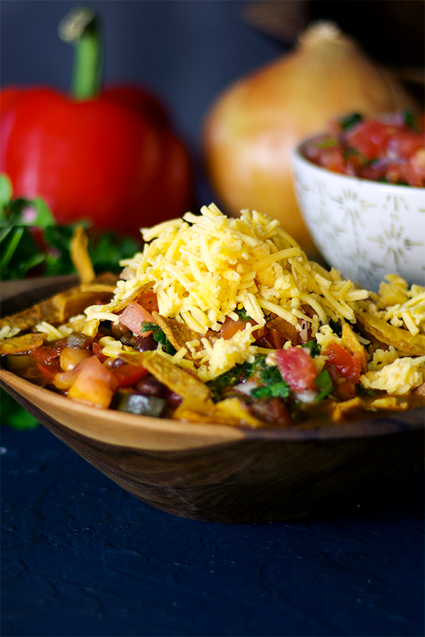 Vegetarian chili with pico de Gallo, cheese, and fried tortilla strips.