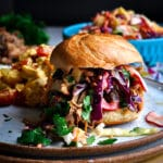 A pulled pork sandwich with pineapple coleslaw.