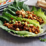 A plate of chicken lettuce wraps.