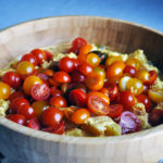 Mustard potato salad with fresh cherry tomatoes.