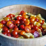 Mustard potato salad with fresh cherry tomatoes.