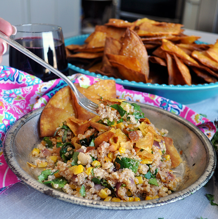 A forkful of Southwest Quinoa Salad and homemade tortilla chips