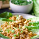 Chicken lettuce wraps with roasted peanuts.