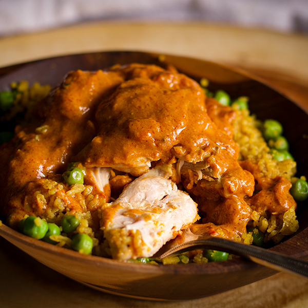 A bowl of Homemade Indian Butter Chicken with Indian Rice.