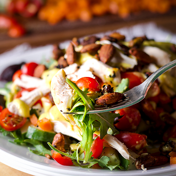Taking a bite of roast chicken salad with mango dressing.