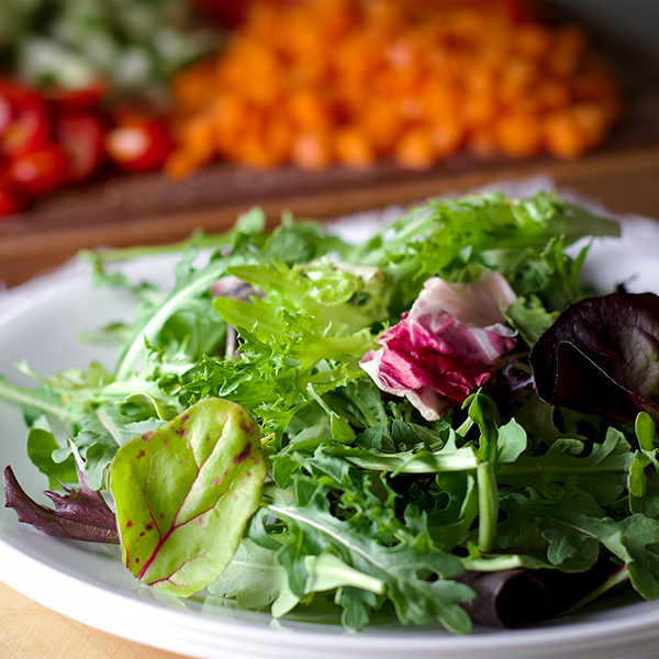 A plate of salad greens.