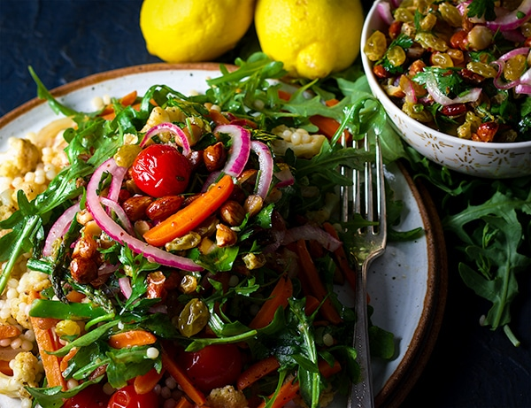 A plate of couscous and vegetable salad with Agrodolce.