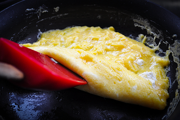 Turning a French Omelette in the pan.