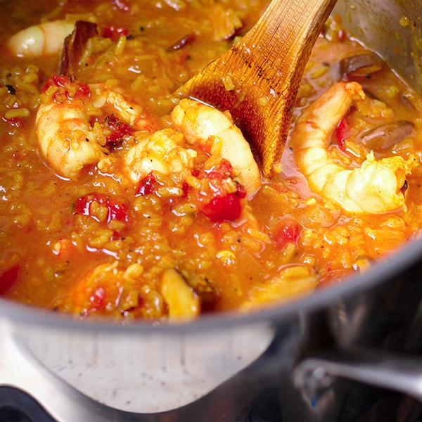 Stirring a pot of Shrimp, Rice, and Shiitake Mushroom Soup.