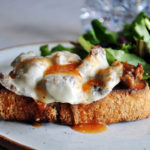 Open face sausage and provolone sandwiches with roasted tomato sauce