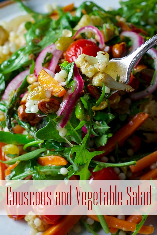 Taking a bite of couscous salad with vegetables and Agrodolce.