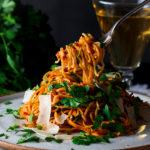 Taking a bite of Spaghetti Puttanesca.