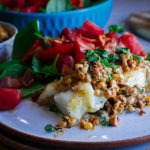 Skillet cooked cod fillets with creamy corn relish and tomato salad.