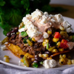 Black Bean Tostadas with Corn Salsa and Enchilada Cream.