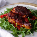 Paprika Chicken with Marinated Peppers on arugula salad.