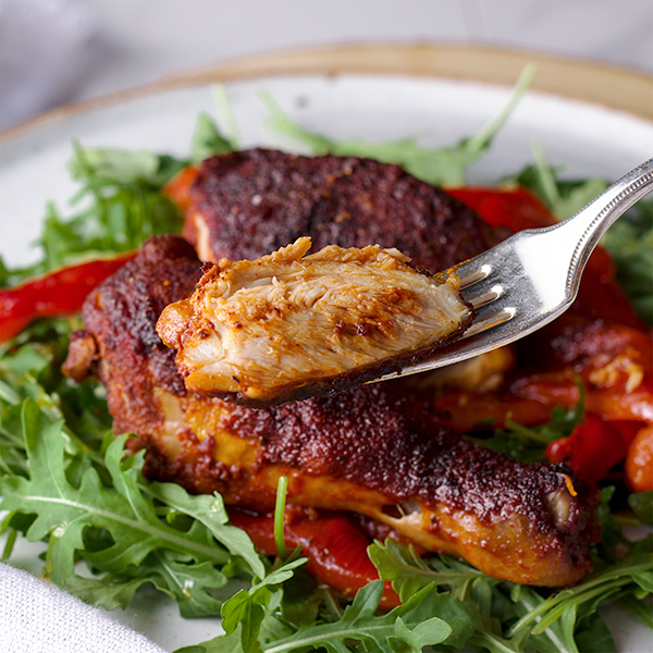 Taking a bite of Paprika Chicken with Marinated Peppers.