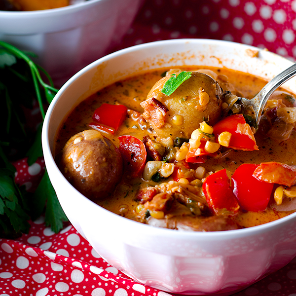 A bowl of southwest summer corn chowder with potatoes and peppers.