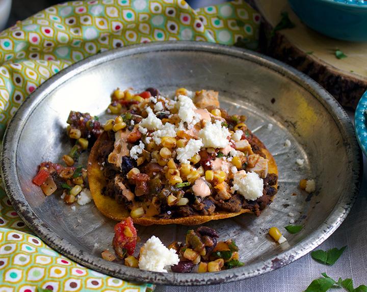 Black Bean Tostada with Corn Salsa and Enchilada Cream