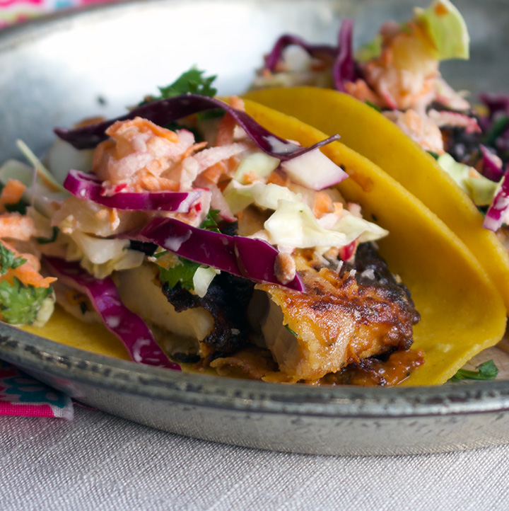 Chili marinated mahi-mahi-mahi fish tacos with pineapple coleslaw.