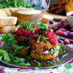 Fried chicken sandwiches with savory mayonnaise, arugula, and spicy cranberry relish.