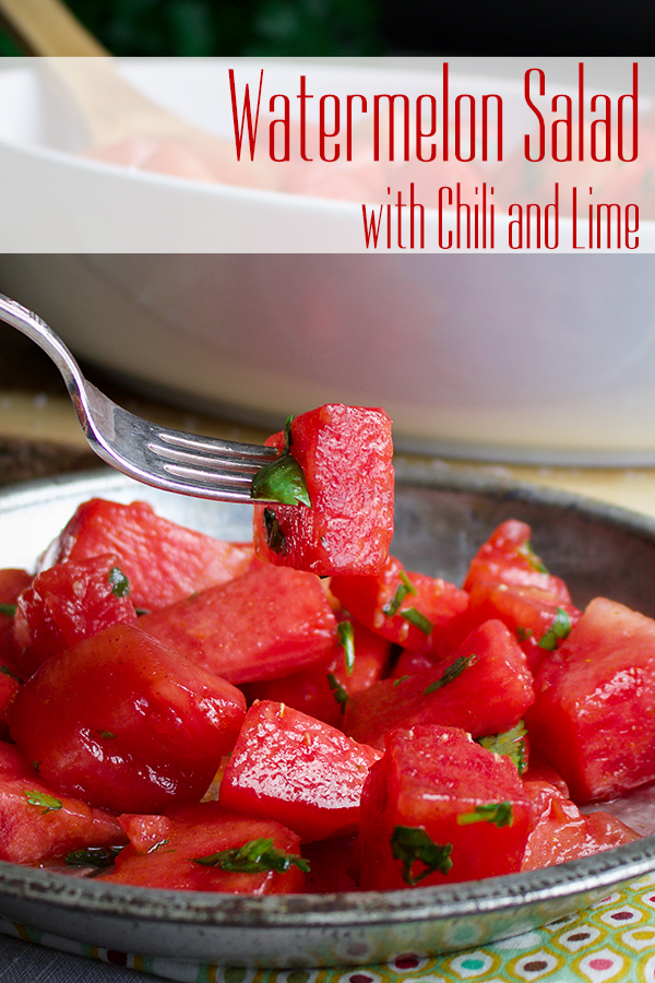 Taking a bite of watermelon salad with chili and lime.