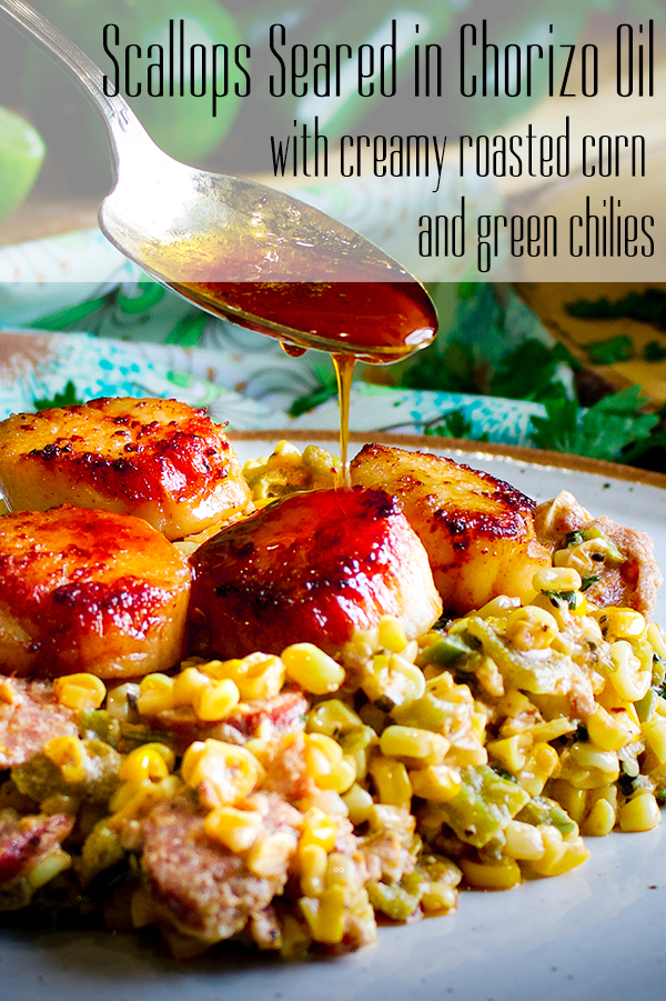 Drizzling chorizo oil over a plate of pan seared scallops and creamy roasted corn with green chilies.