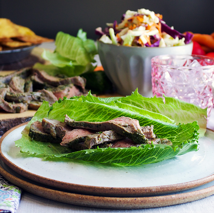 Strips of flank steak in lettuce wraps