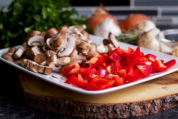 Mushrooms, red peppers, garlic and onions, ready to add to a pot of Tuscan Braised Beef.