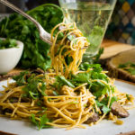Taking a bite of Vegetarian Spaghetti Carbonara.