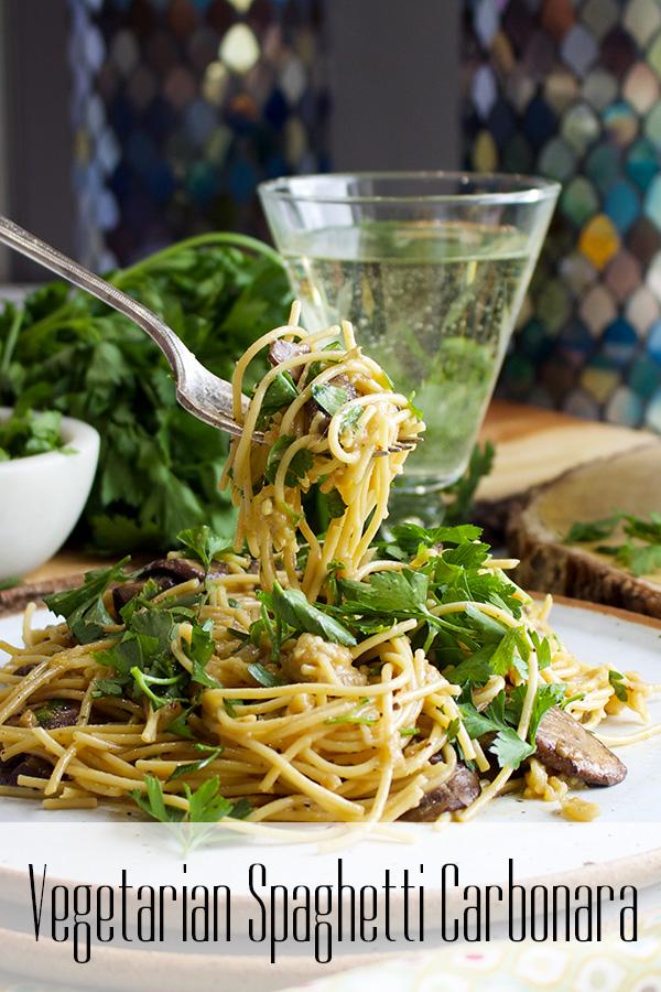 Taking a bite of Vegetarian Spaghetti Carbonara