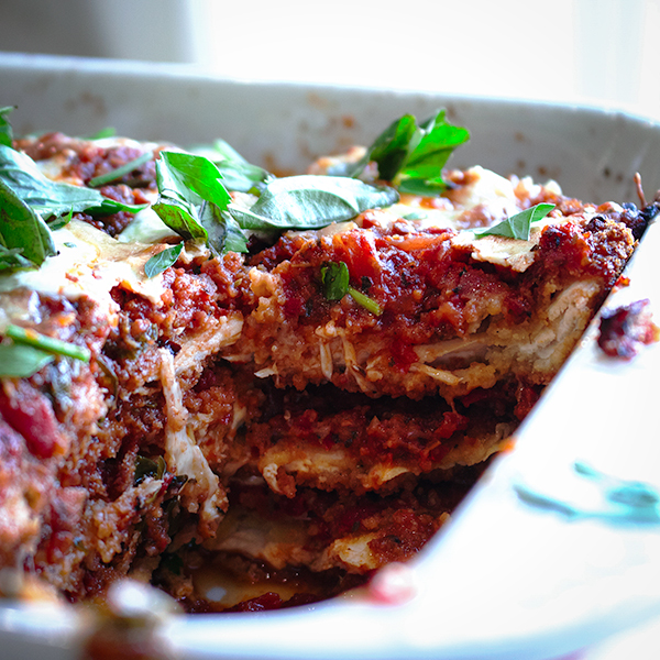 A casserole dish of chicken and eggplant parmesan.