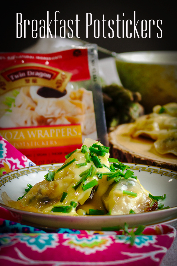A plate of breakfast potstickers smothered in Hollandaise sauce.