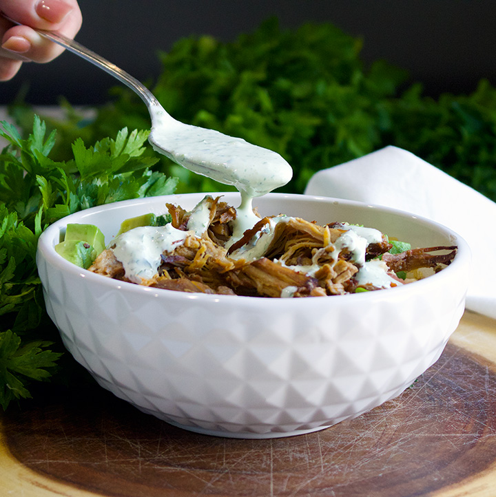 Drizzling Jalapeño Cream on Quinoa Veggie Carnitas Bowls